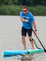 After recovering from a brain injury in 2007 and utilizing the help of Johns Hopkins Brain and Stroke Rehabilitation Program, Corey Davis founded the Ocean Games in 2014 to raise awareness and money for Johns Hopkins.