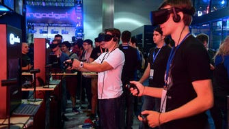 "Gaming fans wearing VR goggles play ""Echo Arena"" from Oculus at the E3 conference in Los Angeles."