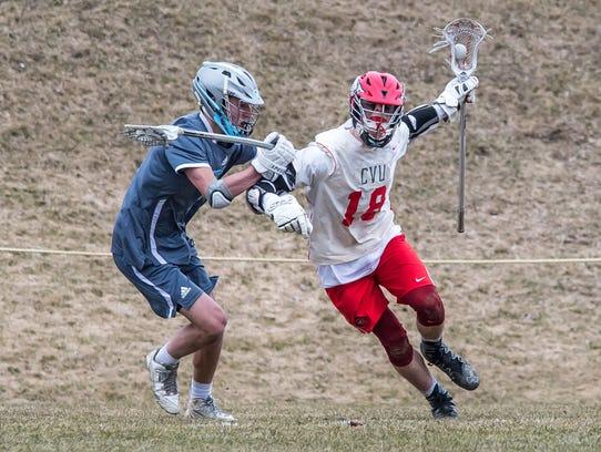 CVU's Will Braun fights up field against So Burlington's