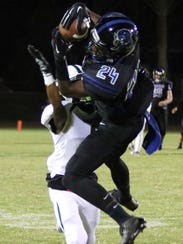 Cathedral City's James Green III completes a pass against