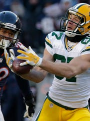 Wide receiver Jordy Nelson catches a 60-yard pass while being covered by Chicago Bears cornerback Cre'von LeBlanc to set up the winning field goal in a December 2016 game.