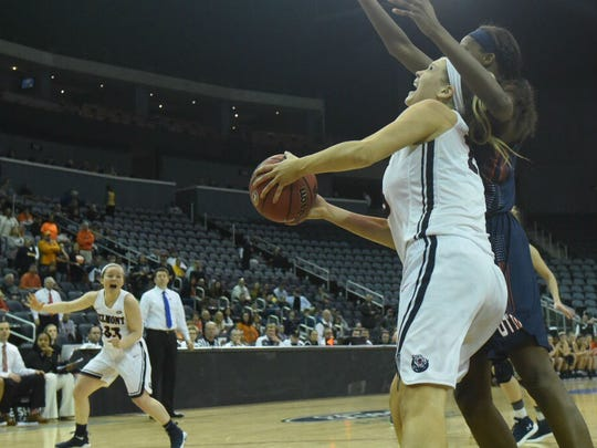 Belmont's Kylee Smith works to get a shot off in overtime