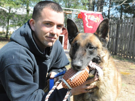 Derrick Magee and his dog TTroy shown here in April