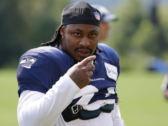 FILE -In this Aug. 2, 2014, file photo, Seattle Seahawks running back Marshawn Lynch walks on the field during NFL football training camp in Renton, Wash. Police in Bellevue, Washington, are investigating whether Lynch was involved in an assault and damage of personal property.  The Bellevue Police Department released a statement Monday morning, Aug. 11, 2014,  saying that the alleged incident took place around 2:30 a.m. Sunday and that Lynch is alleged to have been involved. (AP Photo/Ted S. Warren, File)