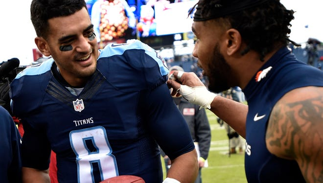Titans quarterback Marcus Mariota (8) signs an autograph after the 13-10 win over the Broncos on Sunday.