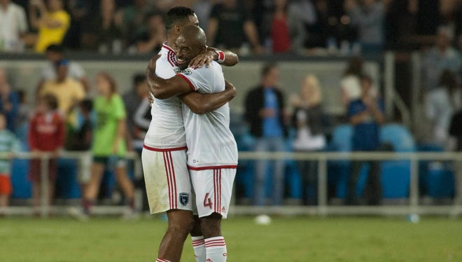 San Jose Earthquakes midfielder Anibal Godoy (30) and defender Marvell Wynne (4) celebrate after defeating the Los Angeles Galaxy at Avaya Stadium.