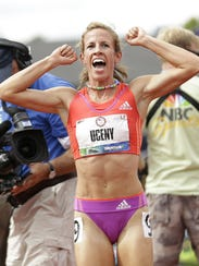 Morgan Uceny celebrates after winning the women's 1,500