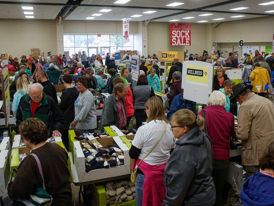 Shoppers peruse boxes of socks during the annual Fox