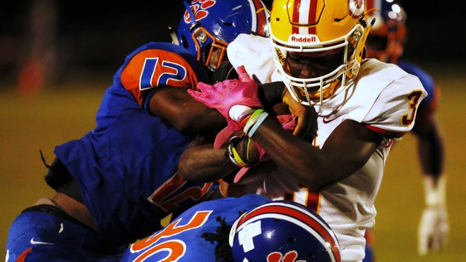 Clarke Central's Nono Mack is tackled by Cedar Shoals' defense during last season's game at Waters-Wilkins Stadium.