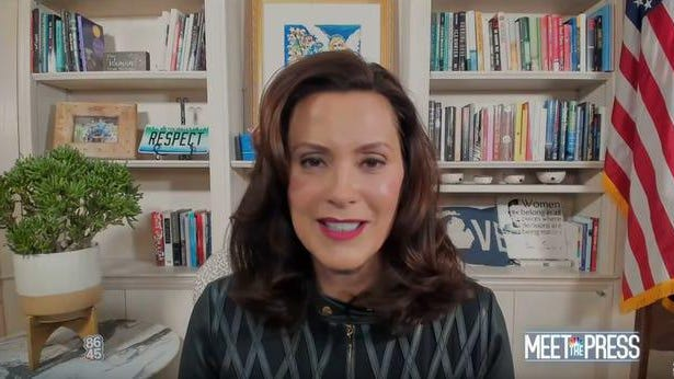 """Michigan Gov. Gretchen Whitmer speaks on NBC's """"Meet the Press"""" on Sunday, Oct. 18. A pin with the numbers """"8645,"""" an anti-Trump message, can be seen in the background."""
