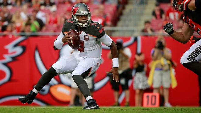 Tampa Bay Buccaneers quarterback Jameis Winston (3) gets pressured against the Cleveland Browns during the first quarter at Raymond James Stadium.