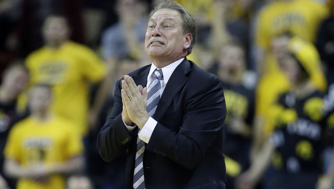 Michigan State head coach Tom Izzo, here is a moment of reflection, reaction or prayer against Iowa, is starting to receive criticism from surly fans.