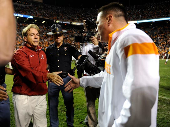 Alabama coach Nick Saban shakes hands with Tennessee