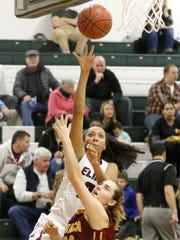 Zaria DeMember-Shazer of Elmira goes up for a shot as Sidonie Lazarus of Ithaca defends Wednesday during a Section 4 Class AA semifinal at Elmira High School. DeMember-Shazer had a triple-double in Elmira's win over Horseheads on Dec. 17 and is a Division I recruit as a junior.