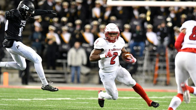 La Salle's Jarell White rushes for a first down Thursday night during the Div. II state championship.
