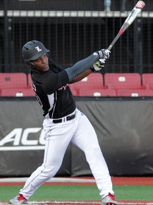 Josh Stowers (25) hits a home run during their team scrimmage at Jim Patterson Stadium at the University of Louisville in January.