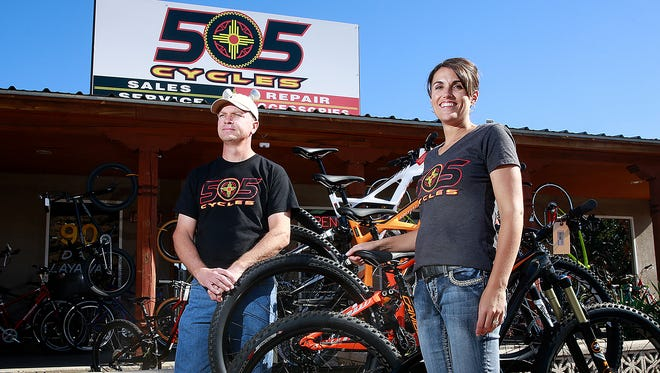 Mike Wulfert, left, and Michelle Wulfert stand outside 505 Cycles on Wednesday at 4301 East Main St. in Farmington.