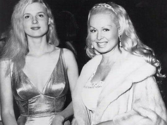 "Alexis Hunter (left) attends the 1971 premiere of ""The"