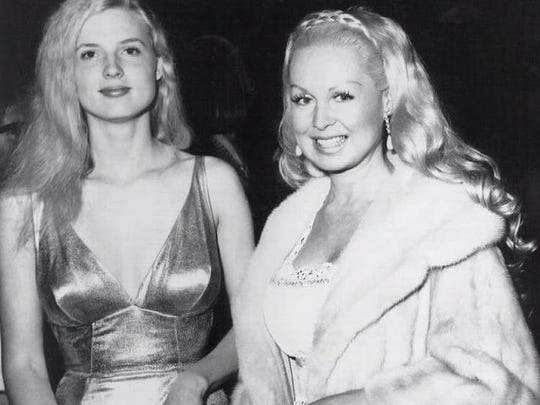 """Alexis Hunter (left) attends the 1971 premiere of """"The Indomitable Dr. Phibes"""" with Joi Lansing"""