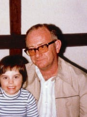 Phillip G. Seifert is pictured with his granddaughter, Nicole. Seifert was shot to death during a robbery on Jan. 14, 1991, at the former Hi-Way Inn on Governor Printz Boulevard.