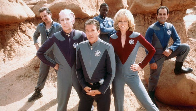 The cast of the 1999 comedy GALAXY QUEST.  From left:  Sam Rockwell, Alan Rickman, Tim Allen, Daryl Mitchell, Sigourney Weaver, Tony Shalhoub.  Credit: DreamWorks Pictures.