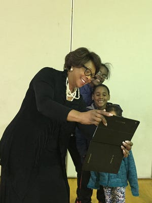 East Ramapo Superintendent Deborah Wortham takes a selfie with students after a community meeting in Monsey about a Dec. 6 bond vote.