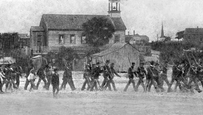 Kenedy Rifles march through Corpus Christi on their way to the San Antonio & Aransas Pass (SAAP) depot to take the train to Austin, where they were reformed as Company E and trained for deployment in Cuba in the Spanish-American War in 1898.