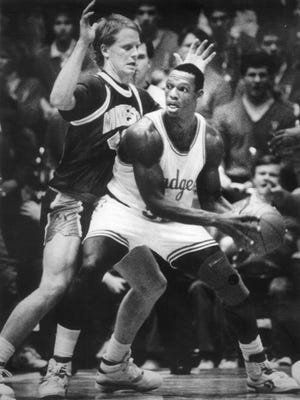 Wisconsin's Danny Jones, with ball, is guarded by Minnesota's Jim Shikenjanski. The two were rivals for seven years, with Jones also starting for three years at Boylan and Shikenjanski at Hononegah.