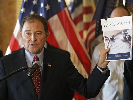 This Dec. 4, 2014, file photo, shows Gov. Gary Herbert speaking during a news conference unveiling details about his alternative to expanding eligibility for Medicaid in Utah, in Salt Lake City. A Utah doctors' group is speaking out against lawmakers' plan to have doctors, hospitals and others pay most of the cost of expanding the state's Medicaid rolls. Herbert and Republican legislative leaders say doctors and other practitioners would benefit from having more patients covered by Medicaid and they should help pay the $78 million price tag to insure more of Utah's poor. (AP Photo/Rick Bowmer, File)