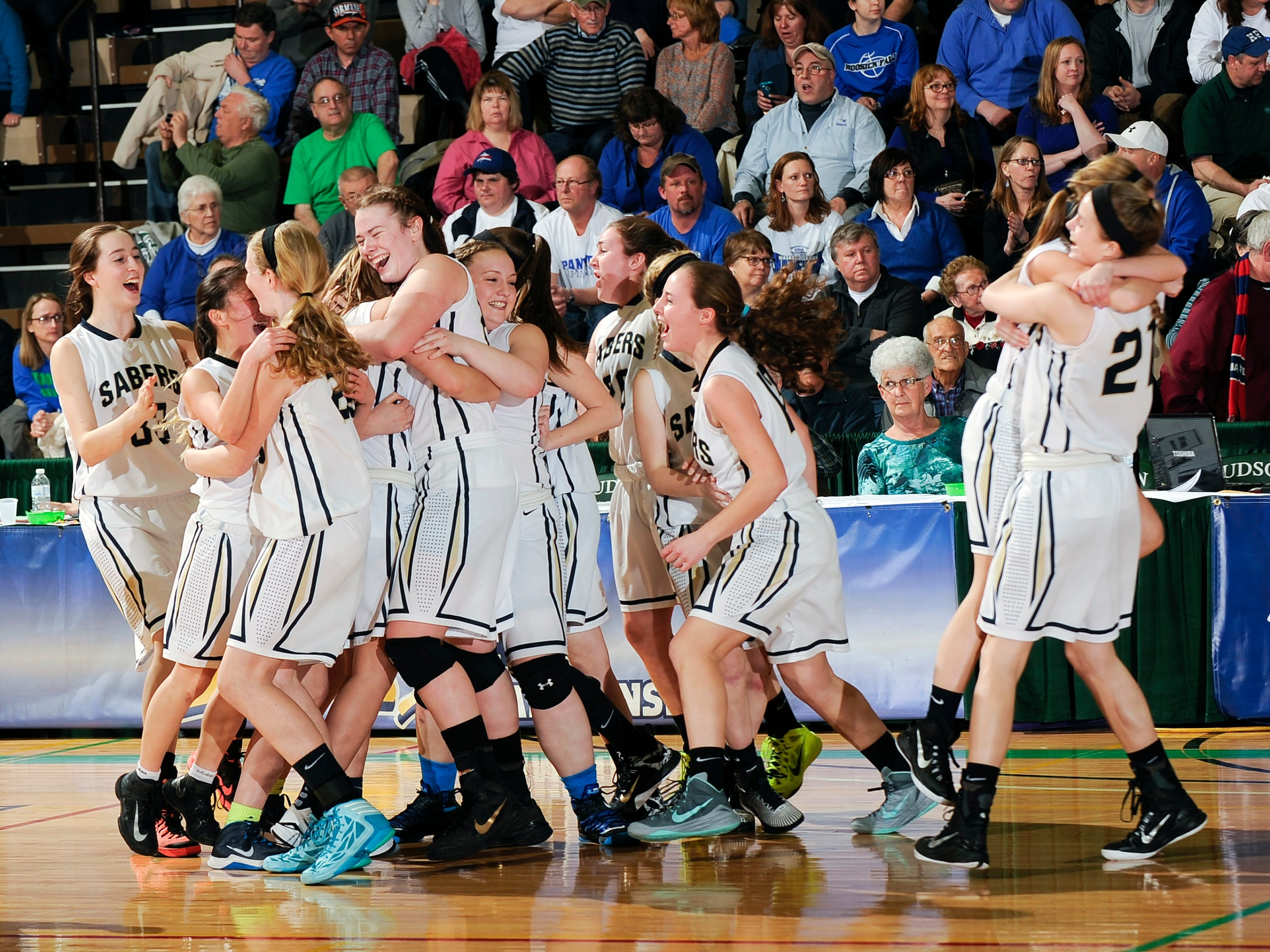 The Susquehanna Valley girls basketball team celebrates winning the Class B state title after a 51-45 victory Saturday.