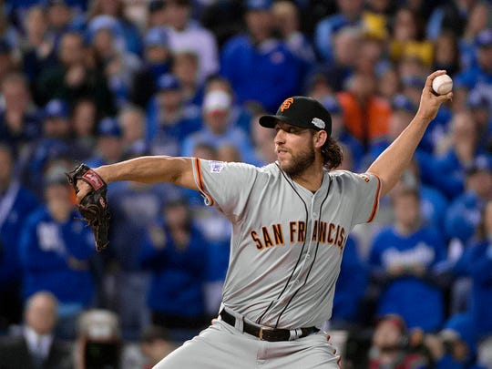 San Francisco Giants relief pitcher Madison Bumgarner (40) pitches in the bottom of the fifth inning of Game 7 of baseball's World Series against the Kansas City Royals Wednesday, Oct. 29, 2014, in Kansas City, Mo.