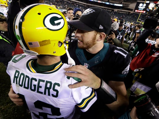 Philadelphia Eagles' Carson Wentz, right, and Green Bay Packers' Aaron Rodgers meet after an NFL football game, Monday, Nov. 28, 2016, in Philadelphia. Green Bay won 27-13. (AP Photo/Matt Rourke)