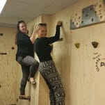 Kingman Museum Director Kelly VanRyswyk and Education Manager Heather Stratton complete the Horizontal Shredder at Fitness Pros.