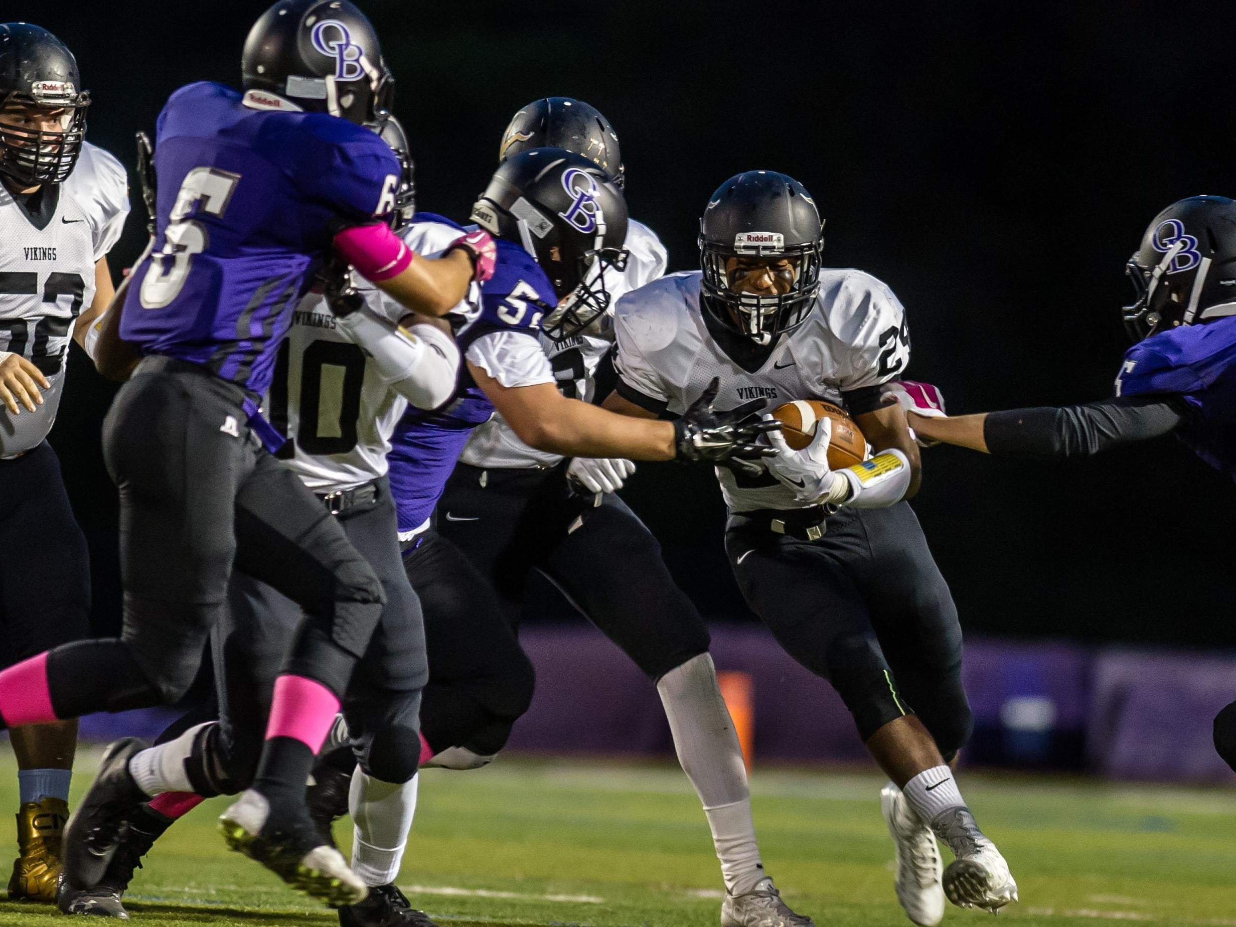 South Brunswick's Phil Campbell breaks through for extra yards against Old Bridge during their game in Old Bridge on Sept. 25, 2015. Photo by Jeff Granit