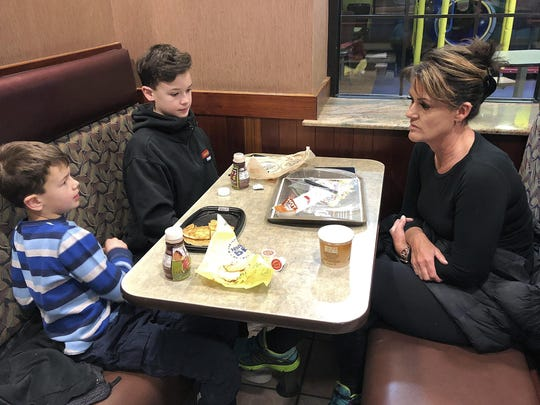 Tamra Cartwright, right, talks with sons Connor, 7, left, and Caden, 11, about the effect of multiple aftershocks from Alaska's recent magnitude 7.0 earthquake while interviewed in Anchorage, Alaska.