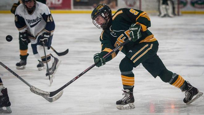 BFA St. Albans' Georgia Babb bounces a shot off the Essex defense during a high school girls hockey game earlier this season.
