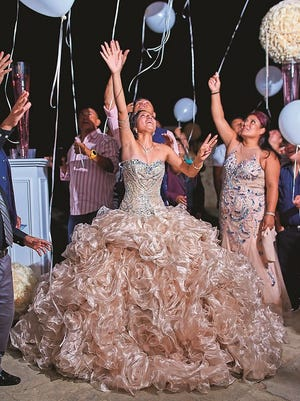 Rosita Rosales celebrates with family and friends at her quinceañera party.