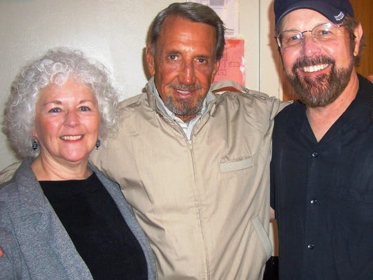 """David O'Malley and his wife, Karen, pose with actor Roy Scheider during filming of the TV movie """"Dark Honeymoon"""" in 2008."""