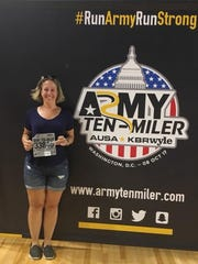 Chambersburg's Megan Hill-Haymaker poses with her race bib before last weekend's Army Ten-Miler in Washington D.C.