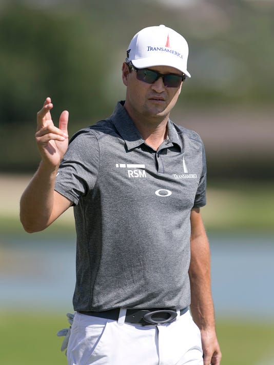 Zach Johnson waves to the gallery after his birdie putt on the third green during the third round of the Sony Open golf tournament, Saturday, Jan. 16, 2016, in Honolulu. (AP Photo/Marco Garcia)