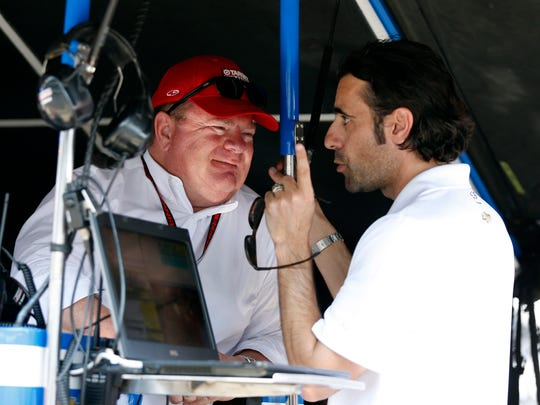 May 22, 2016; Indianapolis, IN, USA; Verizon Indy Car owner Chip Ganassi talks with three time Indy 50 winner Dario Franchitti during qualifications for the Indianapolis 500 at Indianapolis Motor Speedway. Mandatory Credit: Brian Spurlock-USA TODAY Sports