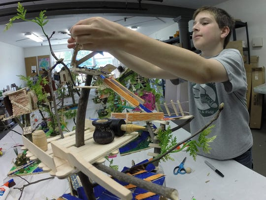 Jonathan working on his tree house architecture project.