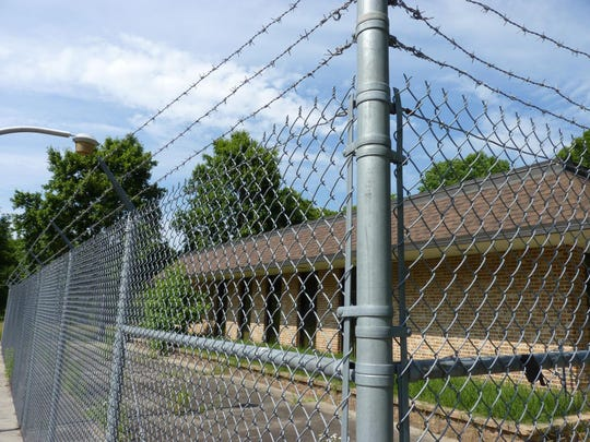 Barbed wire fences off a Burlington County rest stop that was once named for shock jock Howard Stern.