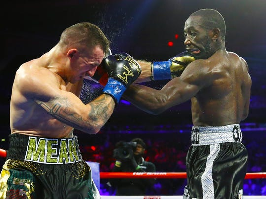 Egidijus Kavaliauskas (left) gave Terence Crawford more trouble than expected but ultimately faded and was knocked out. Mikey Williams / Top Rank