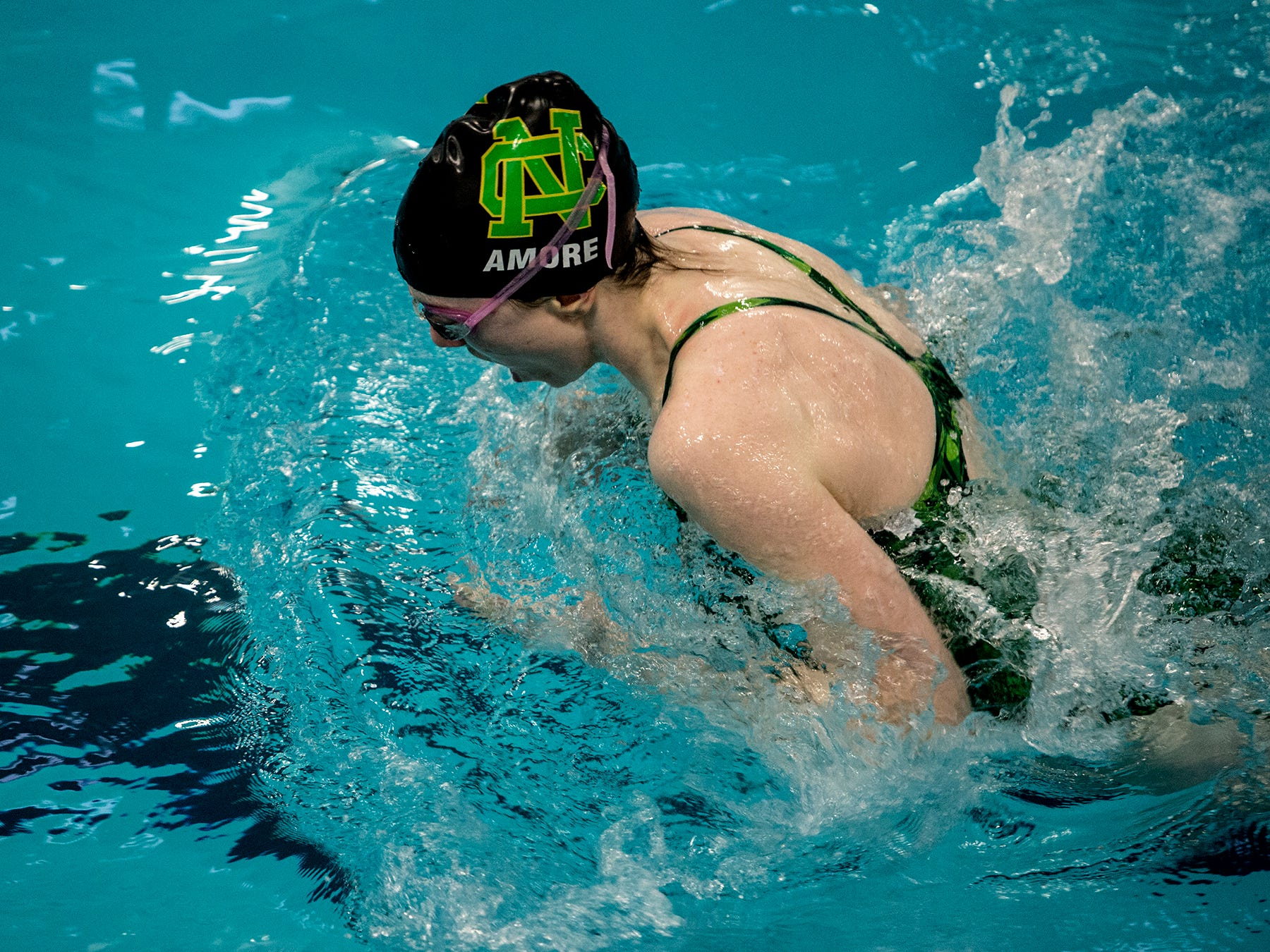 Newark Catholic's Rose Amore swims the breaststroke in the 200 medley relay Saturday during the Division II sectional meet at Columbus Academy.