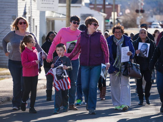 Dozens of marchers make their way up Port Republic Road during a celebration of Martin Luther King Jr.'s life in Waynesboro.