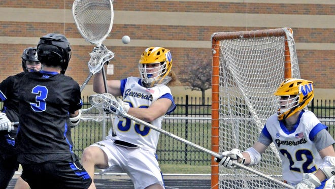 Wooster goalie Jack Shaw deflects this a close-range shot on goal by Hilliard Bradley's Matt Humphreys (3) as Wooster's Evan McGhee (22) helps out. Shaw recorded five saves in the Generals' 13-5 win Saturday at Follis Field.