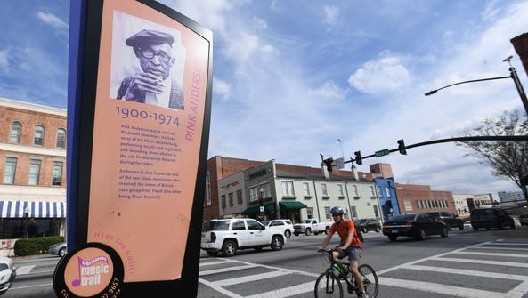 A sign featuring bluesman Pink Anderson on Main St.