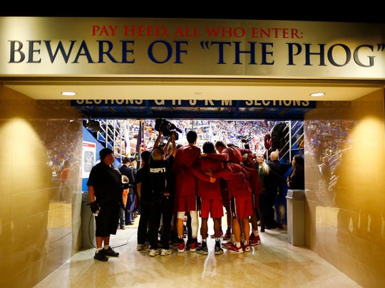 Stanford Cardinal players huddle before taking the court for the game against the Kansas Jayhawks at Allen Fieldhouse on December 3, 2016 in Lawrence, Kansas.