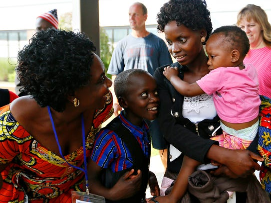 Congolese refugees, from left, Anyesi Chala, Ramadhani